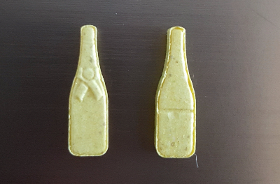 Pill Report: Gold Champagne Bottles